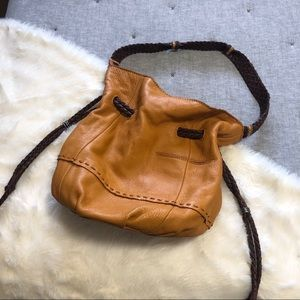 The sak mustard/camel cinch bucket/ hobo purse